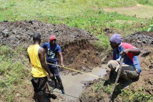 The Water Project:  Taking Measurements During Excavation