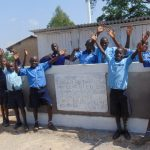 The Water Project: Enyapora Primary School -  Boys Celebrate Their New Latrines