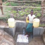 The Water Project: Chegulo Community, Sembeya Spring -  Thumbs Up For Clean Water