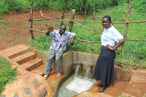 The Water Project:  Community Member With Field Officer Rose Serete