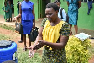 The Water Project:  Trainer Joyce Demonstrating Handwashing