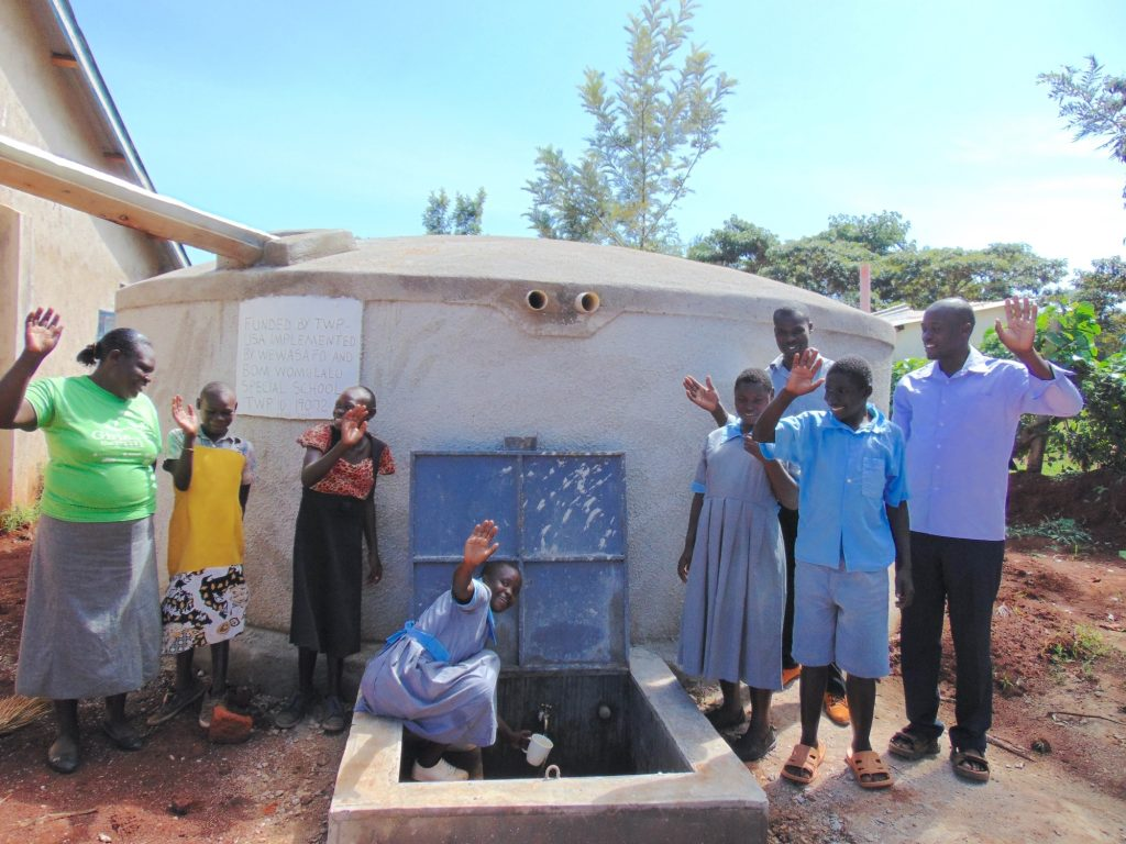 The Water Project : 32-kenya19072-teachers-and-students-celebrate-the-new-tank