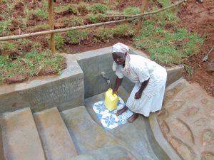The Water Project:  Village Elder Damaris Fetches Water