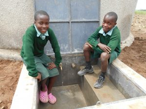 The Water Project:  Students Sit At Rain Tanks Tap