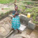 The Water Project: Chegulo Community, Sembeya Spring -  Field Officer Betty Gives Her Approval Of The Spring