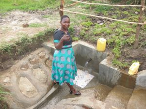 The Water Project:  Field Officer Betty Gives Her Approval Of The Spring
