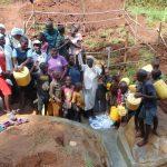 The Water Project: Shamakhokho Community, Imbai Spring -  Damaris In Center Of Community Celebrating The Spring