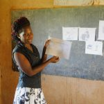 The Water Project: Shinyikha Primary School -  Trainer Lynnah Using Training Illustrations