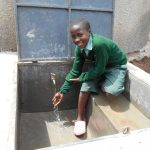 The Water Project: Mukangu Primary School -  Enjoying The Rainwater