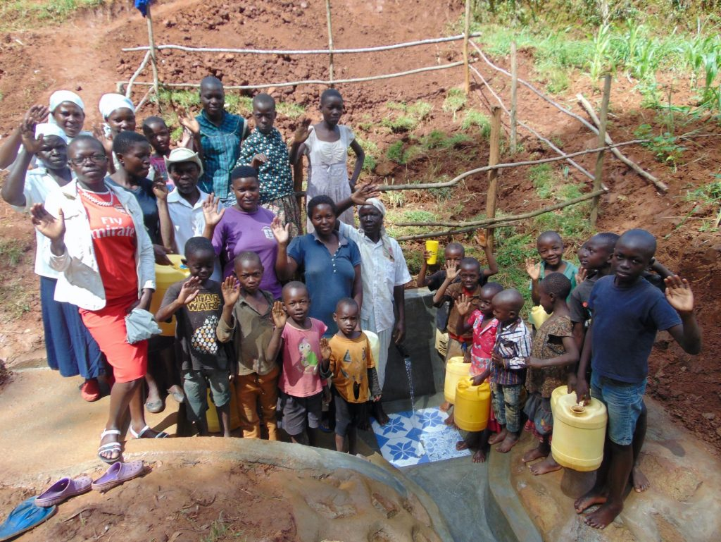 The Water Project : 34-kenya19150-community-members-at-the-spring