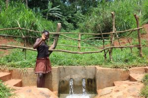 The Water Project:  Posing With The Spring