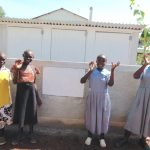 The Water Project: Womulalu Special School -  Girls Pose With Their New Latrines