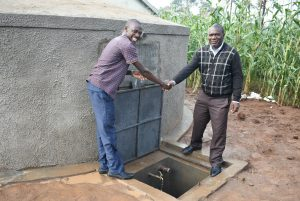 The Water Project:  Handing Over The Rain Tank