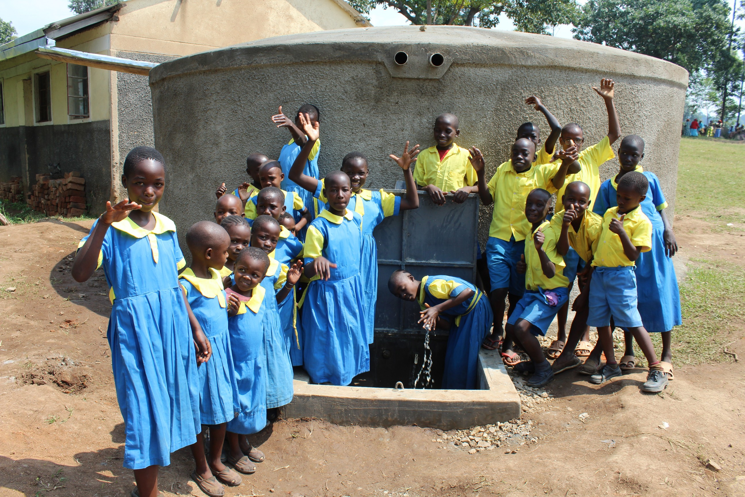 The Water Project : 37-kenya19056-students-celebrate-the-tank