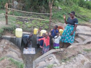 The Water Project:  Betty With Children Celebrating The Spring