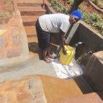 The Water Project: Mushina Community, Shikuku Spring -  Fetching Water