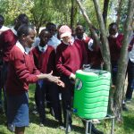 The Water Project: Ematiha Secondary School -  Student Demonstrates Handwashing