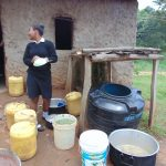 The Water Project: Friends Mixed Secondary School Lwombei -  Student Talks To School Cook While Washing Dishes At The Dishrack