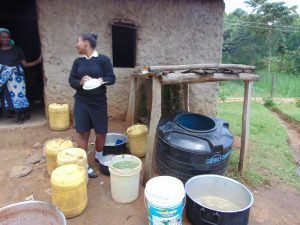 The Water Project:  Student Talks To School Cook While Washing Dishes At The Dishrack