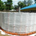The Water Project: Enyapora Primary School -  Plastic Protecting Cement Walls