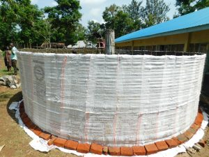 The Water Project:  Plastic Protecting Cement Walls