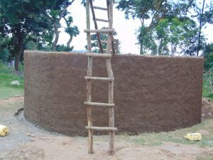 The Water Project:  Ladders Stand Outside Newly Cemented Rain Tank