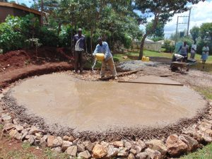 The Water Project:  Adding Water To Concrete Foundation