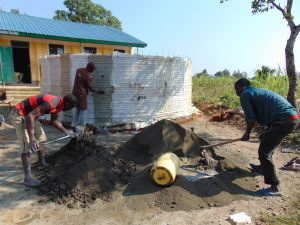 The Water Project:  Mixing Cement For Rain Tank Walls