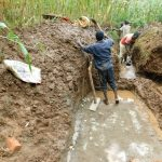 The Water Project: Hirumbi Community, Khalembi Spring -  Laying Foundation While Diverting Water