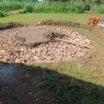 The Water Project: Shinyikha Primary School -  Rain Tank Stone Foundation Receives Concrete