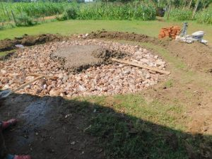 The Water Project:  Rain Tank Stone Foundation Receives Concrete