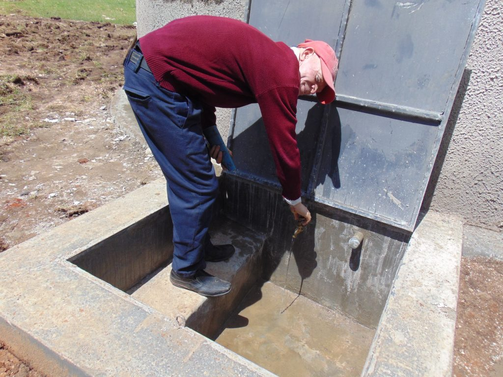 The Water Project : 40-kenya19068-student-at-the-rain-tanks-tap