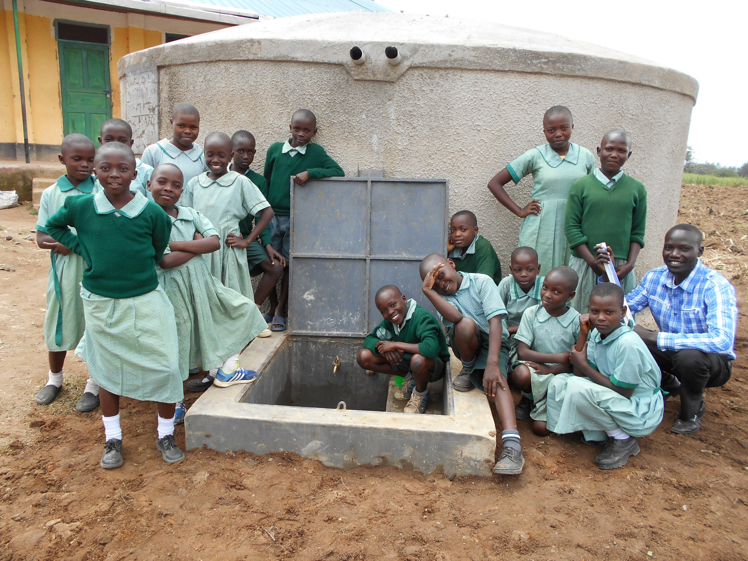 The Water Project : 40-kenya19077-students-and-staff-pose-with-rain-tank