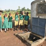The Water Project: Shinyikha Primary School -  Happy Faces At The Rain Tank
