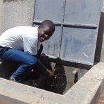 The Water Project: Ematiha Secondary School -  Student Enjoying The Rainwater