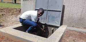 The Water Project:  Student Enjoying The Rainwater