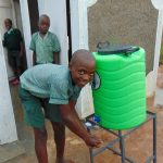 The Water Project: Mukangu Primary School -  Handwashing Outside The Boys Latrines