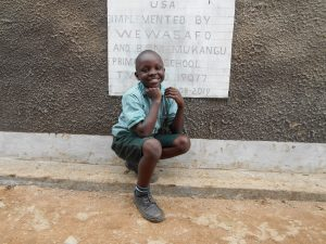 The Water Project:  Student In Front Of Boys Latrines