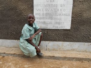 The Water Project:  Student In Front Of Girls Latrines