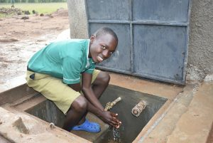 The Water Project:  Washing Hands At The Finished Water Tank