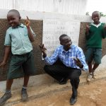 The Water Project: Mukangu Primary School -  Posing In Front Of The Boys Latrines