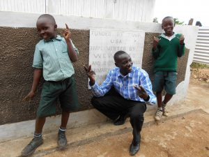 The Water Project:  Posing In Front Of The Boys Latrines