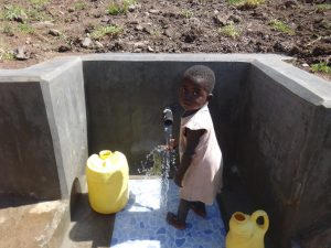 The Water Project:  Feeling The Spring Water