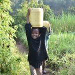 The Water Project: Sichinji Community, Kubai Spring -  Carrying Clean Water Home