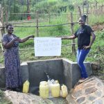 The Water Project: Sichinji Community, Kubai Spring -  Team Leader Emmah Wekesa And A Field Officer Saying Thanks