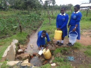 The Water Project:  Students Collecting Water From The Unprotected Spring