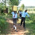 The Water Project: Ebubole UPC Secondary School -  Students Carrying Water