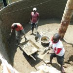 The Water Project: Enyapora Primary School -  Cementing Interior Tank Walls