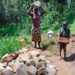 The Water Project: Shamakhokho Community, Imbai Spring -  Community Members Deliver Local Materials
