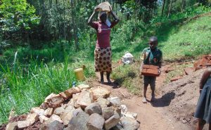 The Water Project:  Community Members Deliver Local Materials
